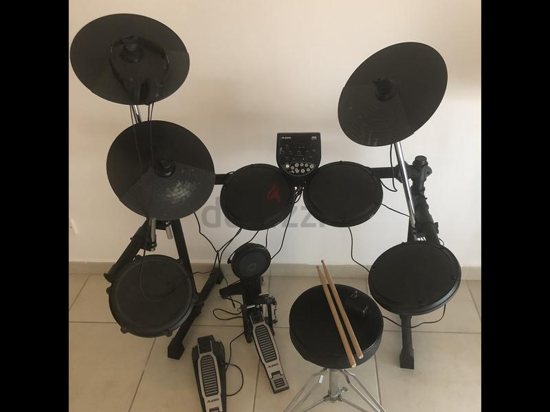 Alesis DM6 drum kit with stool and sticks