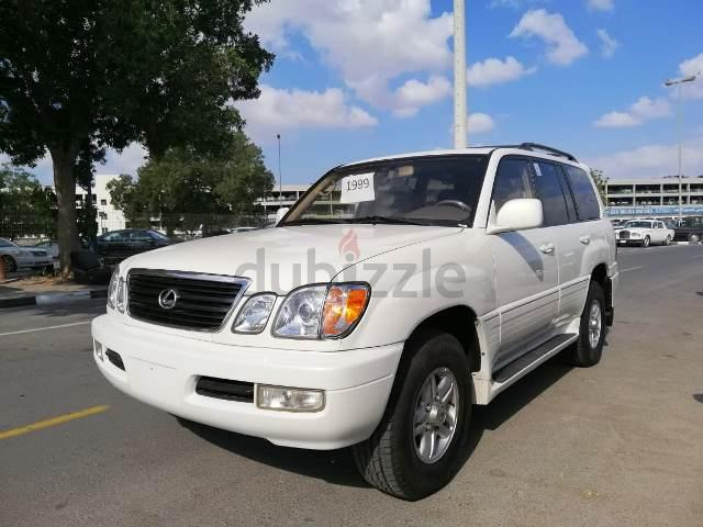 LEXUS LX470 2000 GOLD (WHITE 99 MODEL) NEW ARRIVAL FROM USA WITH CLEAN  TITTLE CARFAX REPORT