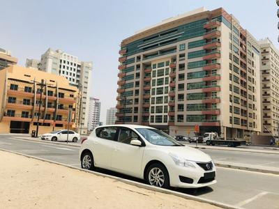 Nissan Tiida 2014 Nissan tiida SV 2014 white GCC specification ...