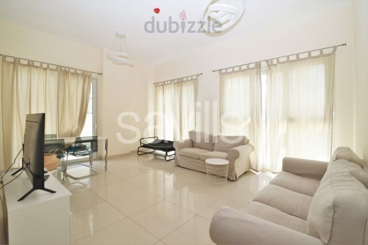Property for Sale photos in Al Zahia: Corner furnished unit with garden on pool - 1