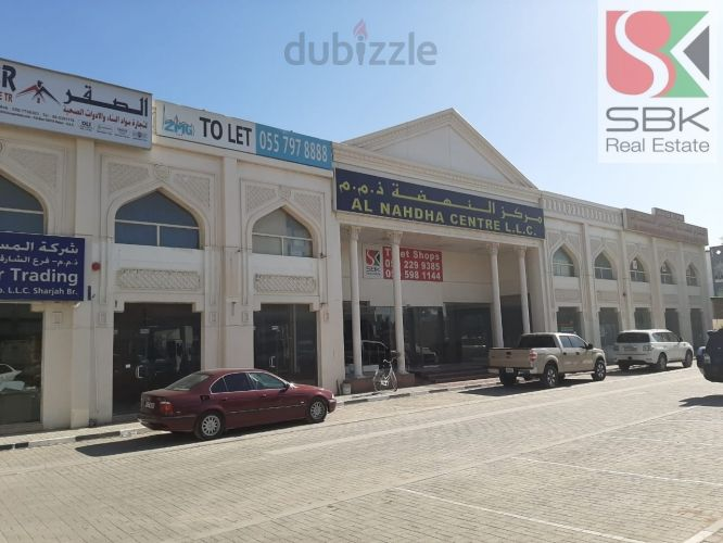 Property for Rent photos in Industrial Area 3: SHOPS Available in Al Nahda Center, Industrial Area - 1