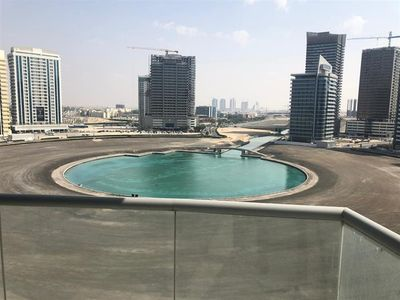 Property for Sale photos in Hub-Golf Towers: Canal View, Large 1 Bedroom for Sale in Hub Canal 1, Sports City - 1