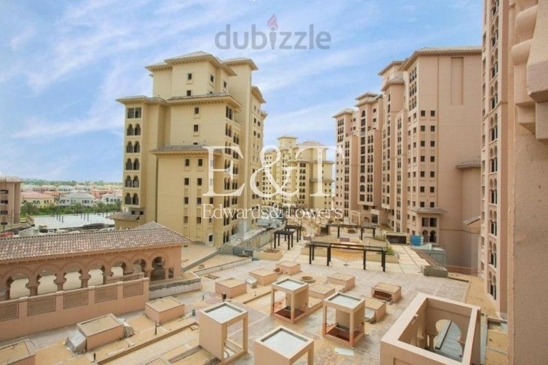 Community Facing| Full Plaza Views | Two Bedrooms