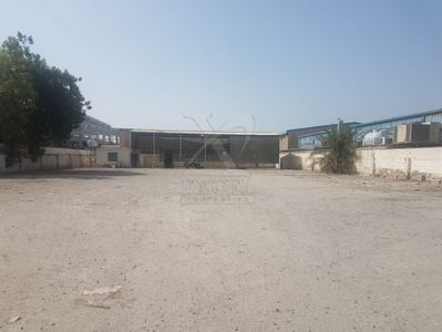 Property for Sale photos in Al Quoz Industrial District: Open Yard | Shed and Office for Sale | 20,000 Sqft - 1